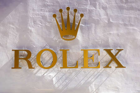 ROME, ITALY - DECEMBER 10, 2020 : Rolex logo on street. Rolex is a manufacturer of high-quality, luxury wristwatches. Trademark was registered in 1908 in Switzerland