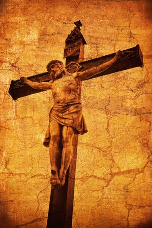 crucifiction: A statue of Jesus Christ crucified on a cross over a grunge background Stock Photo
