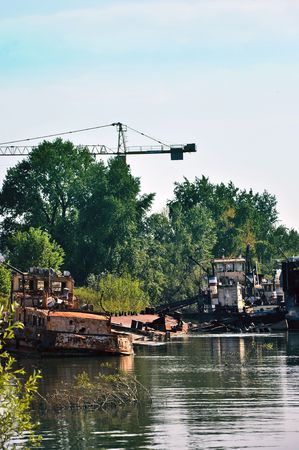 Abandoned sinking ship surrounded by waste on a river bank Stock Photo - 4766077