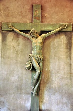 A statue of Jesus Christ crucified on a cross. photo