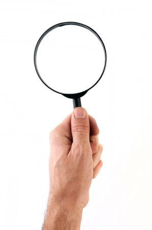 magnifying glass man: hand holding a magnifying glass, isolated on white