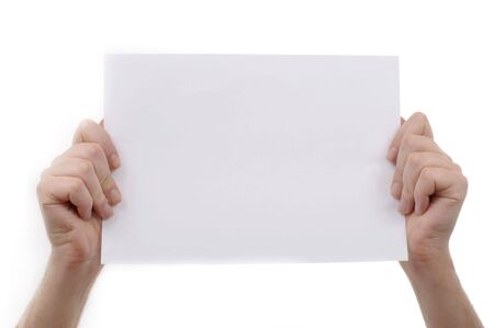 Man is holding a piece of blank white paper, presentation background image. photo