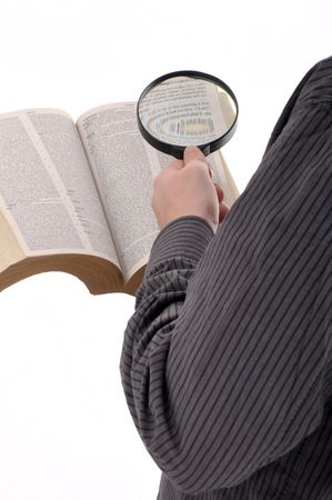 seeking an answer: Man is looking up for a term in a dictionary book