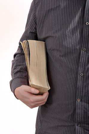 utterance: Man is holding a book in his right hand