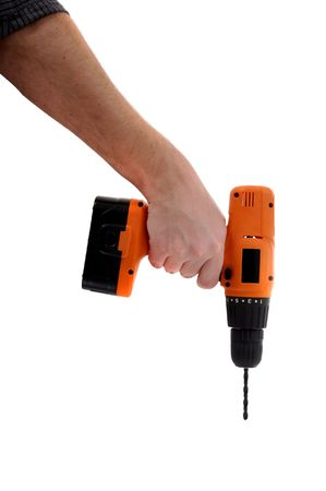 amend: Man is holding an orange handy drilling tool, house work Stock Photo