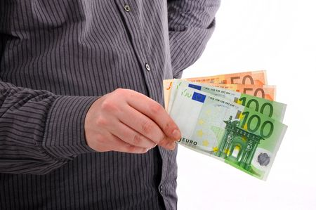 Man is paying with euro banknotes, financial background photo