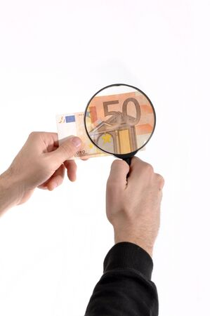 Man is inspecting a euro banknote with magnifying glass Stock Photo - 6254044