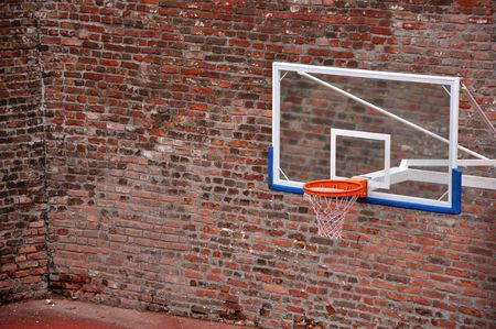 playground basketball: Basketball hoop and an empty outdoor court.