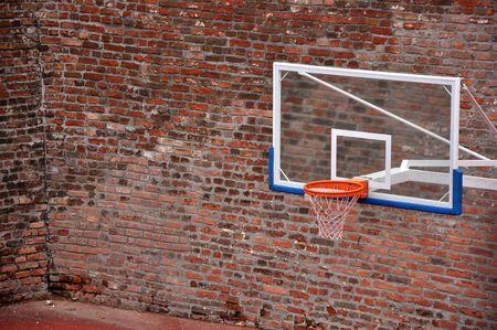 terrain: Basketball hoop and an empty outdoor court.