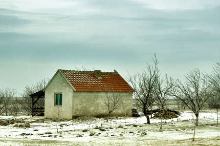 Small old house, winter scenery, late afternoon photo