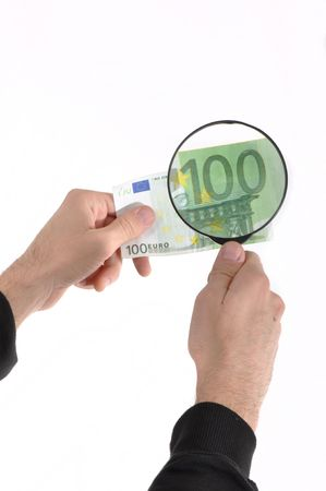 Man is inspecting a euro banknote with nagnifying glass Stock Photo - 6398144