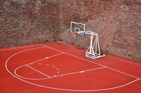 Basketball hoop and an empty outdoor court. photo