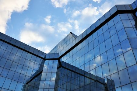 corporate office building with large, glass windows Stock Photo