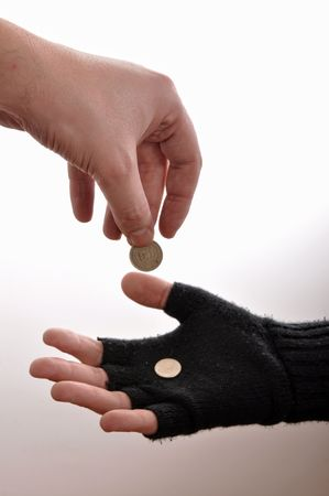 humiliated: Beggar man hand with coins, image is isolated on wgite background. Stock Photo