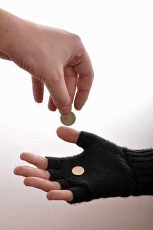 underprivileged: Mano di uomo mendicante con monete, immagine � isolato su fondo wgite. Archivio Fotografico