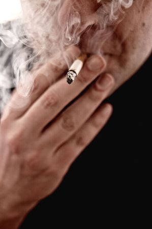 banning the symbol: Close up image of a man smoking a cigarette, isolated on white background