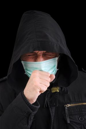 coif: A man with a medical mask covering face, coughing. Stock Photo