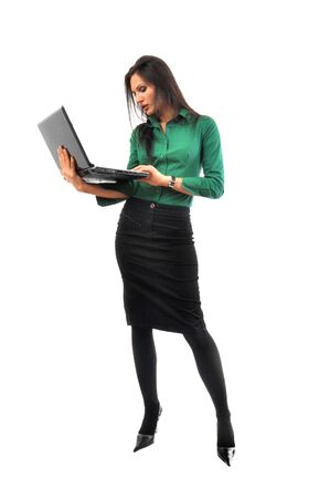 secretary skirt: Young and beautiful business woman with laptop computer