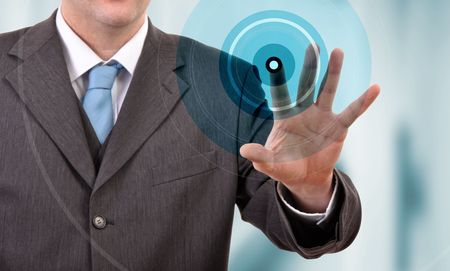biometrics: Businessman pressing a touchscreen button, copyspace  Stock Photo