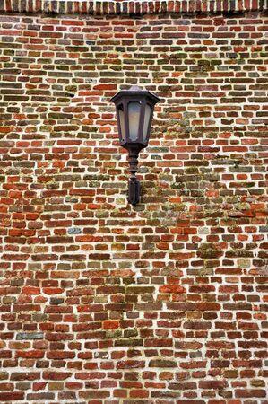 Street lamo on an old brick wall, background image photo