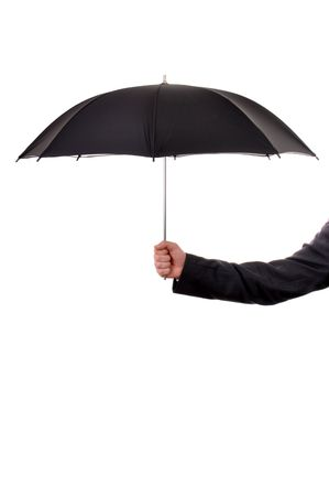 Business man dressed in suite is holding ablack umbrella photo
