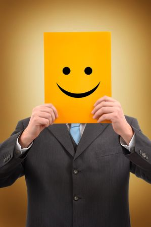 successfull: Businessman in gray suite is holding a yellow folder with happy face drawn on it