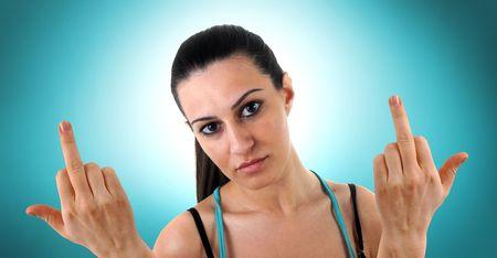 hands off: Mujer joven y triste est� mostrando sus dedos del medio Foto de archivo
