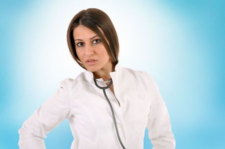 Young and beautiful healthcare worker with stethoscope photo