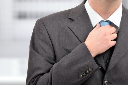 businessman holding a tie, nervous reaction, close up detail. photo