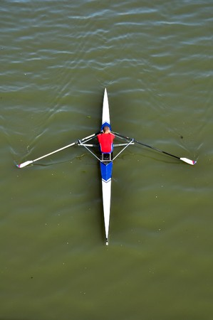 canoe paddle: image of a young man rowing in kayak down the river
