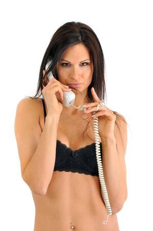 secretaria sexy: Joven y bella mujer conversaciones en el tel�fono Foto de archivo