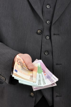Business man is paying with euro banknotes, financial background photo