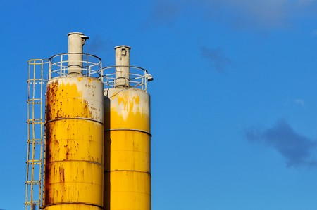 Yellow Towers of temporary cement plant, built for the construction of the building. photo