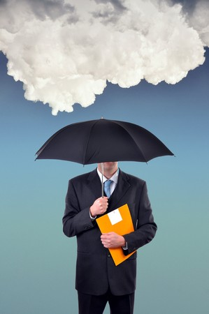 Businessman is holding an umbrella, huge cloud in the background photo