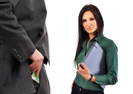 Business man is bribing a female coleague. photo