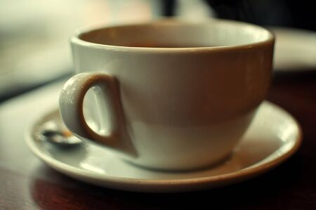 Coffee cup with coffee with shallow depth of field in low light condition photo
