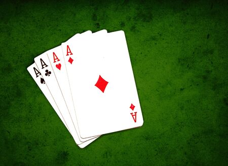 poker, four aces over the grungy green background Stock Photo - 7480726