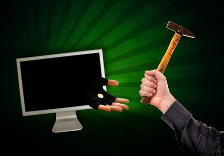 Hand in glove is reaching out from the computer monitor to take your money away, abstract image. Stock Photo - 7531452