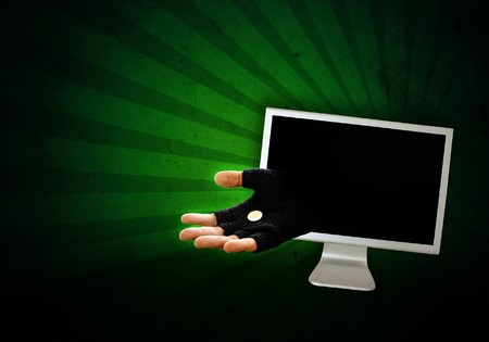 Hand in glove is reaching out from the computer monitor to take your money away, abstract image. Stock Photo - 7558367