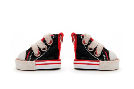 pair of small black sneakers  photo