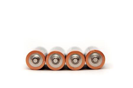 stuartkey: Four AA size batteries over white background. Stock Photo