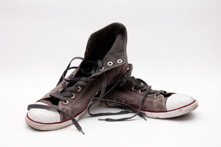 lacing sneakers: pair of old, dirty gray sneakers