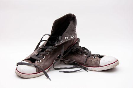 lacing sneakers: pair of old, dirty gray sneakers