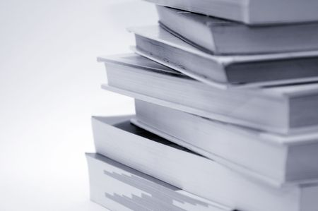 reading and writing: Stack of books over a white background