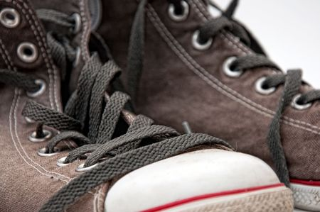 closeup detail of a pair of old, dirty gray sneakers  Stock Photo - 7748367