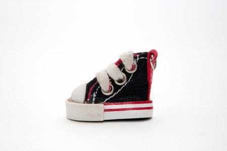 lacing sneakers: pair of small black sneakers