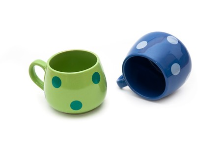 Green and blue empty ceramic coffe cups over a white background with soft shadow photo