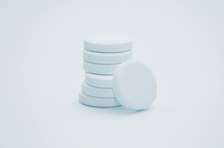 Stacks of multivitamin effervescent tablets, high key Stock Photo - 7854635