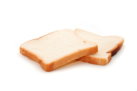 pieces of sliced bread isolated on white background photo