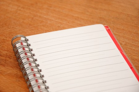 Blank note book with lines on a wooden plate Stock Photo - 7957770